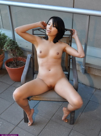 Juvenile oriental is showing off her attractive body outdoors