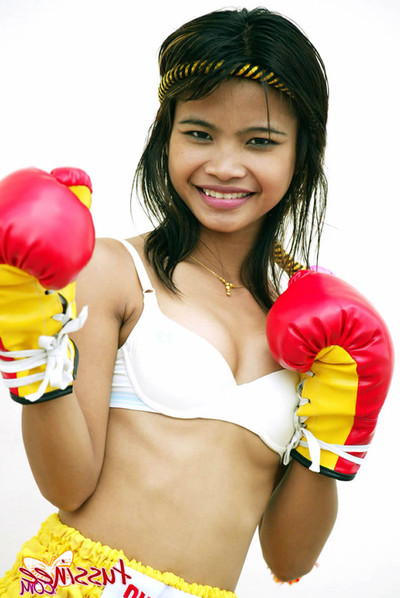 Bangkok young tussinee in a wild muay thai boxing outfit