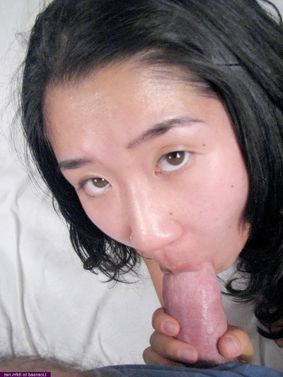 Adolescent oriental giving head to boy who cums in her chop