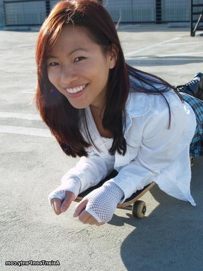 Chinese amateur skateboarder in short skirt