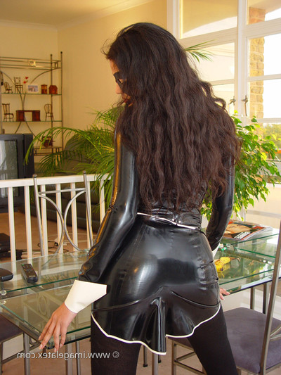 Appealing eastern latex fixation beauty in entire leather costume