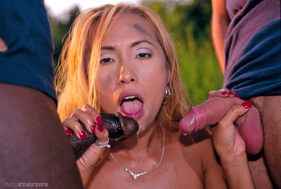 Sexual red haired Japanese orally fixating a ebony and a white knob in int