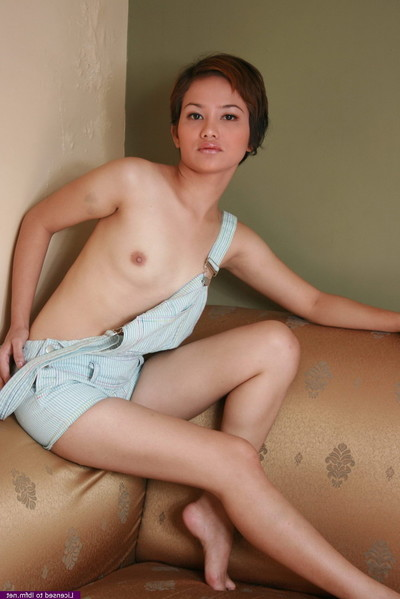 Attractive oriental infant captivating getting uncovered to show sweaty body