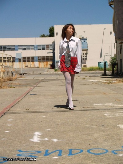 Eastern schoolgirl outside