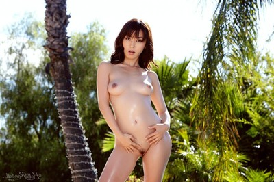 Oriental pornstar removes clothes unclothed by the pool