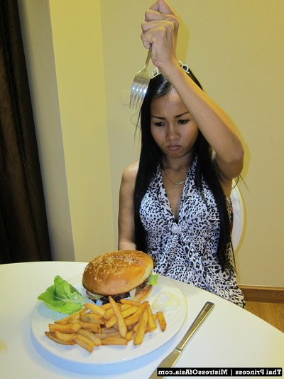 Thai cutie eating burger