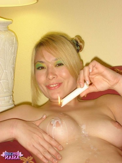Japanese cutie plays with candle on her scoops