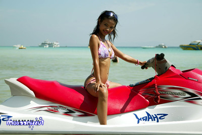 Japanese adolescent example at the beach location on a jet ski