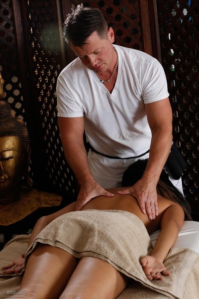 Sexually excited Japanese benefits from attracted on a massage table