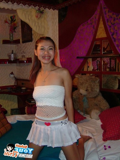 Thai barslut posing in her gogo outfit