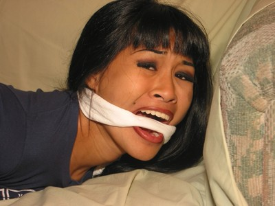 Foot kink and dressed hogtied obedience of gagged eastern young gal