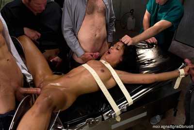 Hot beauty accepts fastened up, punished and drilled by group of dudes