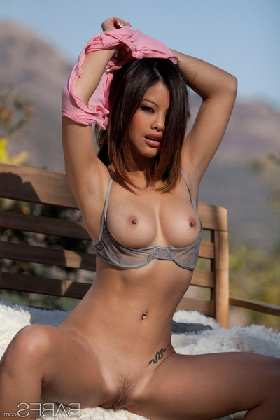 Brunette hair Eastern Exemplar Showing Her Smooth Muff Outdoors