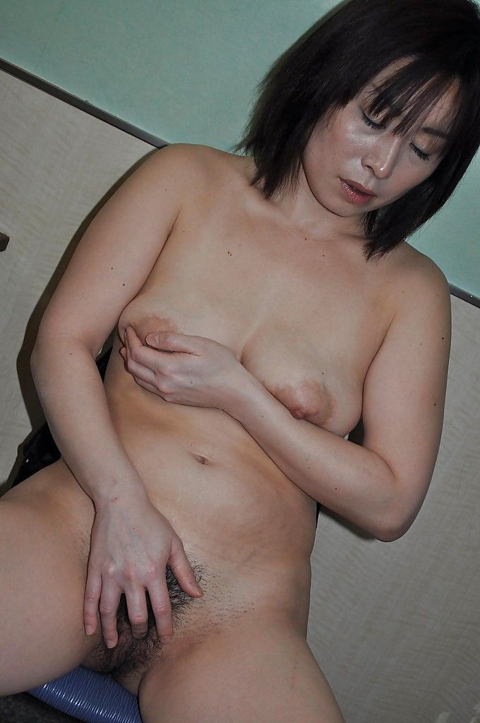 Chinese full-grown Yumi Ohno undressing and vibing her unshaved slit