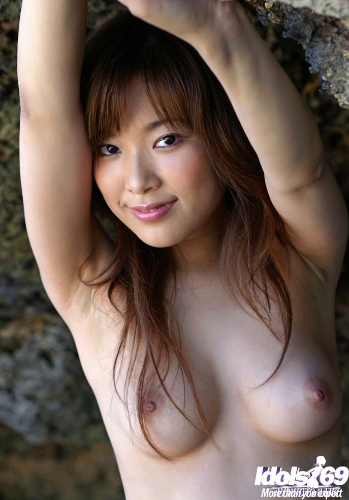 Loveable Japanese model Yua Aida uncovering her sweaty body outdoor
