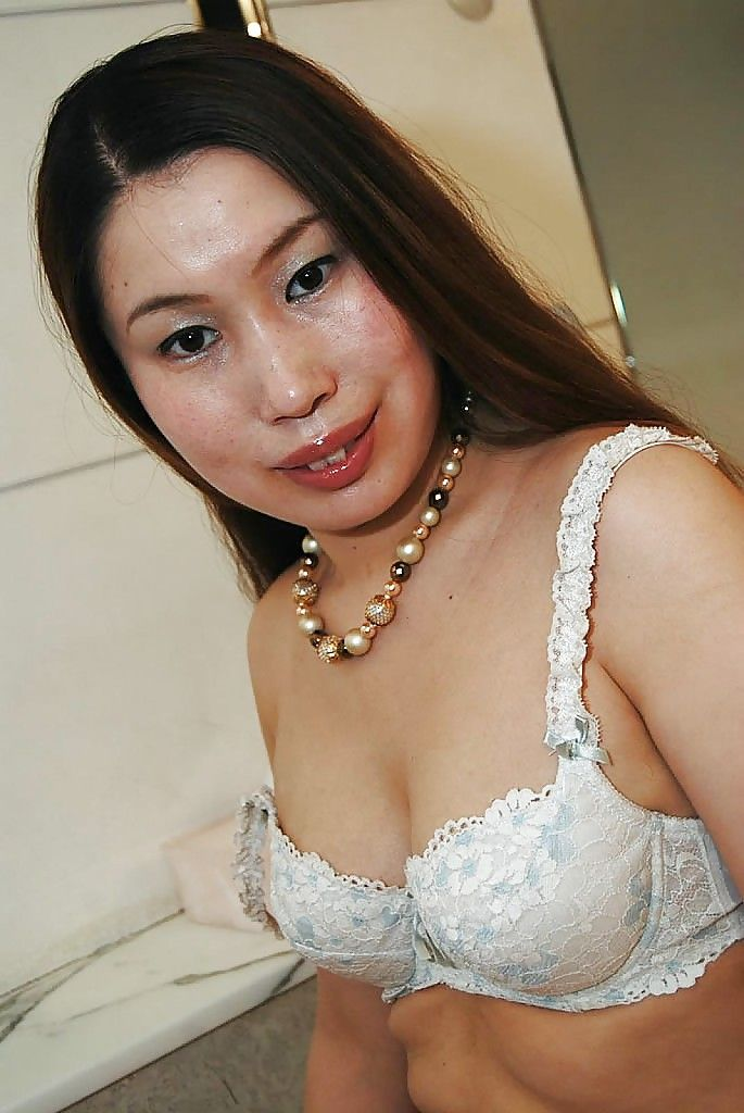 Japanese MILF Ayako Sakuma undressing and showcasing her perspired uterus in close up