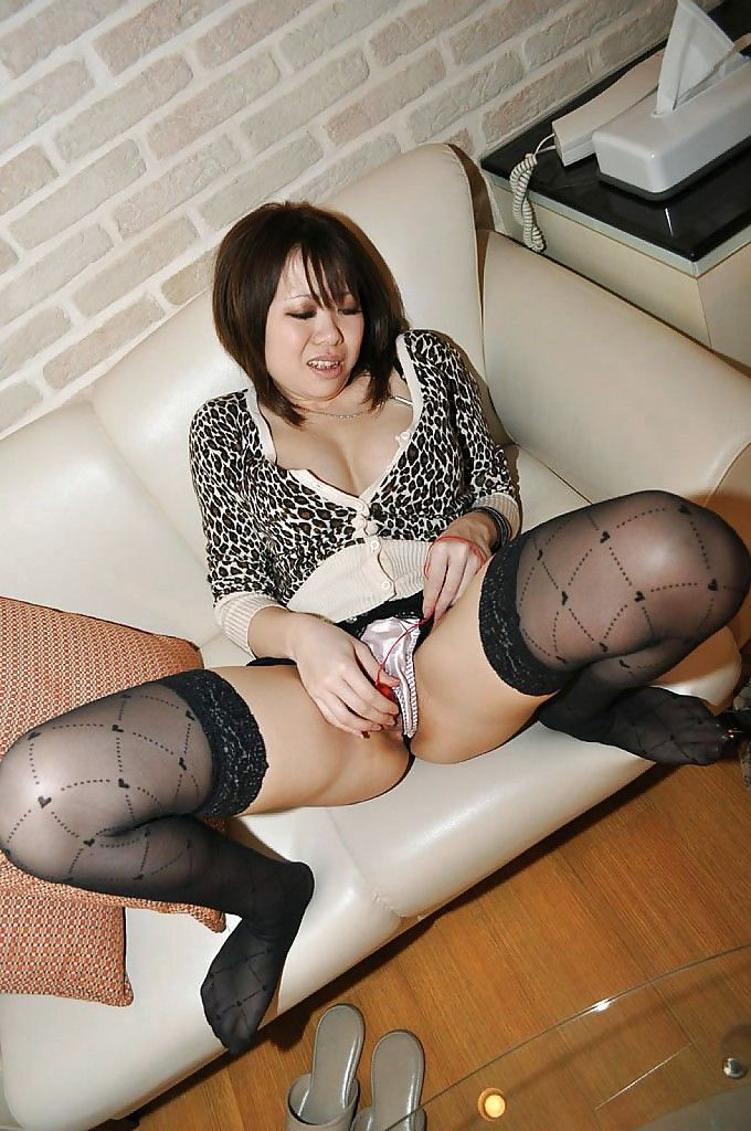 Japanese lassie in stockings Hikaru Ukita undressing and toying her vagina