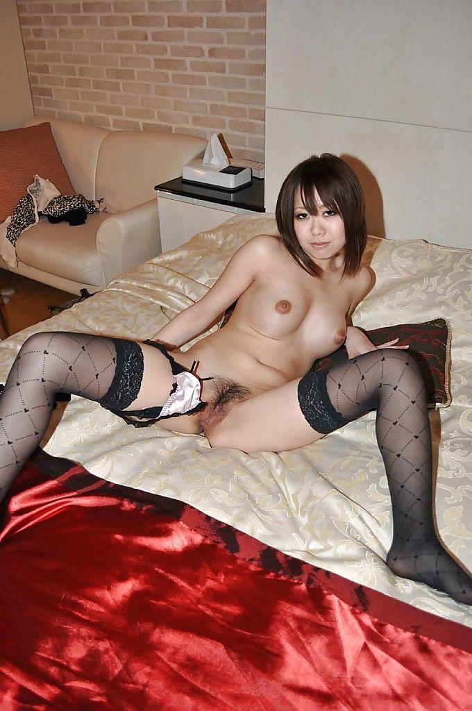 Japanese lassie in stockings Hikaru Ukita undressing and toying her vagina