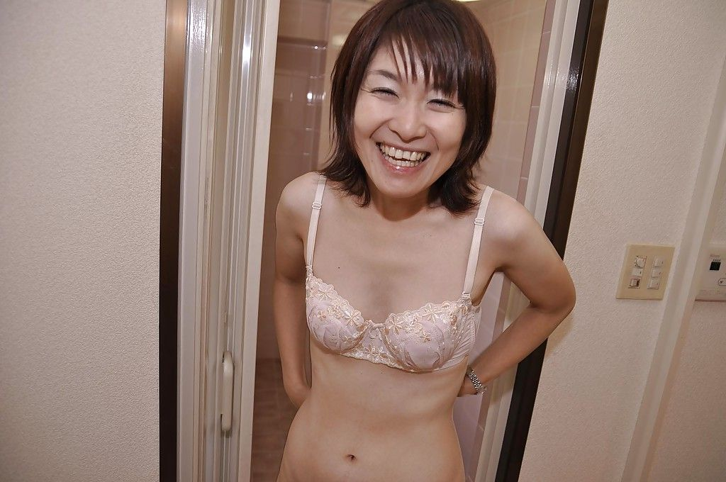 Sassy Japanese MILF with compact boobs Miki Ando undressing and unusual baths
