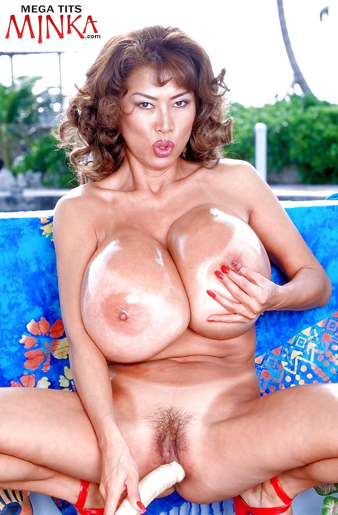 Japanese MILF lass Minka freeing intense knockers from bikini outdoors