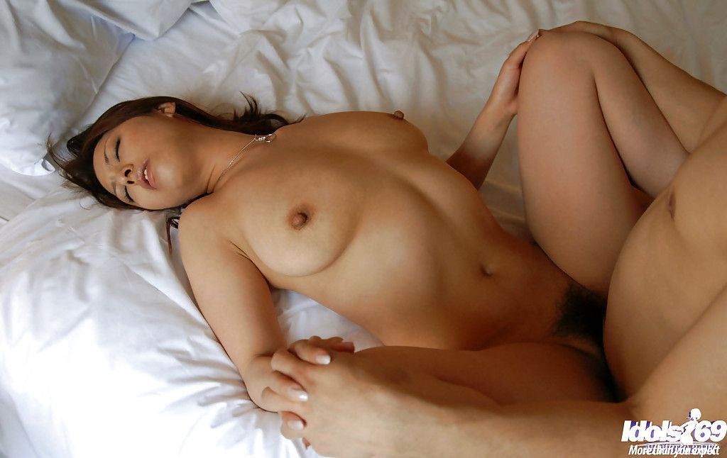 Sassy Japanese hottie gives a titjob and takes a raw phallus in her curly cum-hole