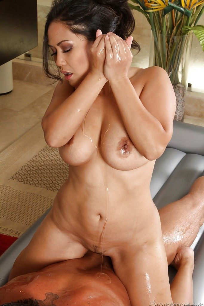 Appealing Japanese MILF gives an oily massage turning fond of raw twatting