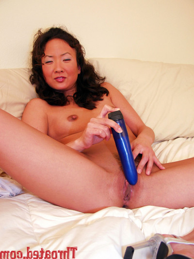 Eastern darling swells legs and vibrators her juicy cum-hole