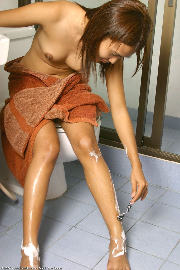 Tattooed Chinese number 1 timer body shaving naughty legs in washroom ahead of showering