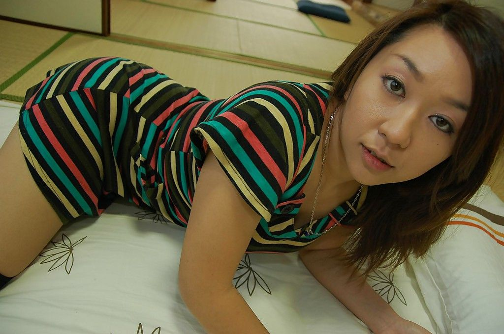 Japanese MILF in nylon knee socks Yuki Otomo undressing and posing unclothed
