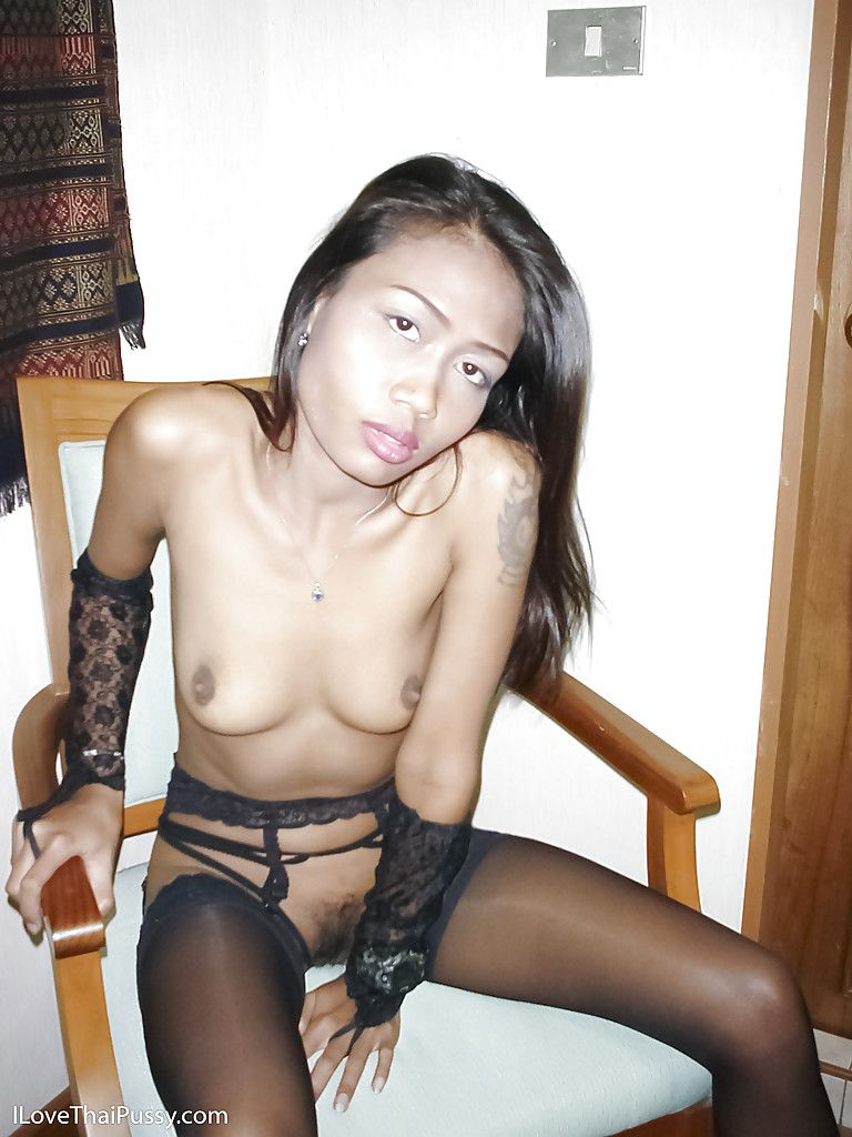 Small Japanese young marsh mellow with thin legs posing in ebony