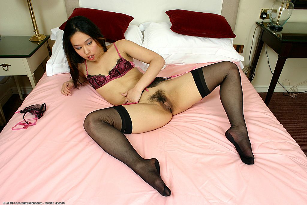 Japanese young in  and garters amplifying beaver right after shedding undies
