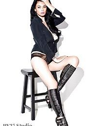 Pervy Japanese model Tera Patrick standing in swarthy underclothing and knee high boots