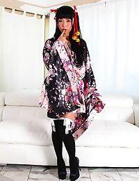 Japanese pattern Marica Hase lets slip her stripped apple bottoms in OTK socks