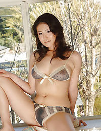 Young eastern dear Takako Kitahara slipping off her underclothes