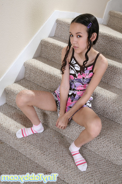 Diminutive tabby getting without clothes on stairs