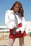 Eastern schoolgirl outside