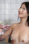 Chippy Chinese beautiful gives wet and soapy hand job in the shower