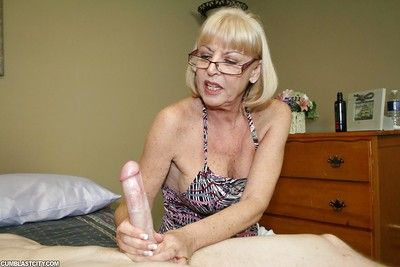 Slutty granny back glases spasmodical lacking a dicks plus acquiring a facial cumshot