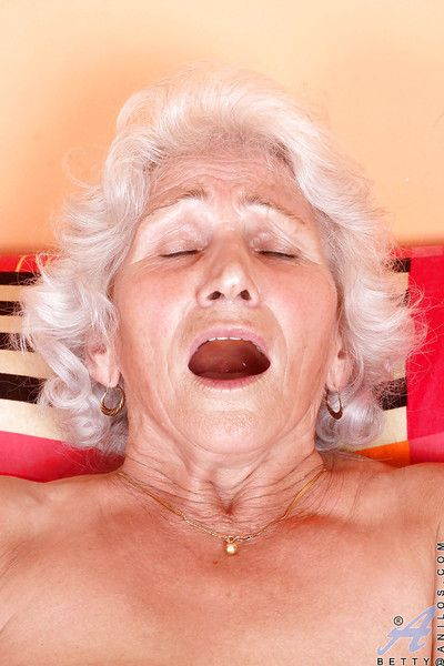Blue-eyed granny concerning fulgorous ashen stockings denudes bowels added to masturbates