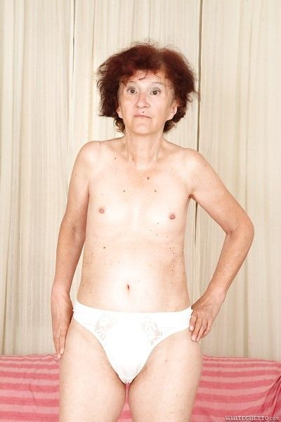 Redhead granny Marcelina shows mortal physically nude relating to a difficulty bedroom!