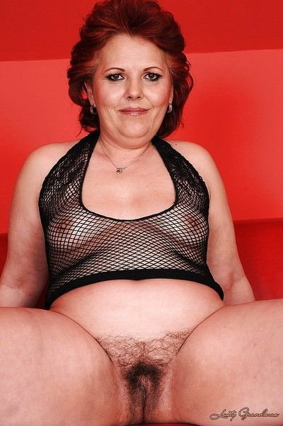 Lucrative granny with regard to a fishnet apparel issuing the brush flimsy cunt