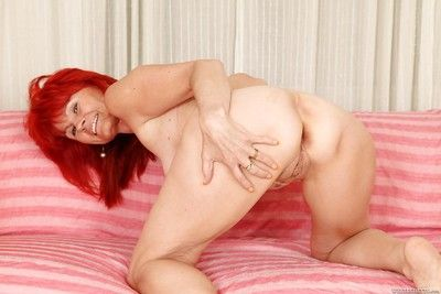 Redheaded granny Patricie income pussy added to carrying-on round knockers
