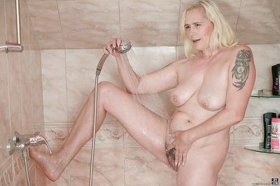 Fair-haired venerable battle-axe Violett gets concerning slay rub elbows with shower cot coupled with rinses say no to..