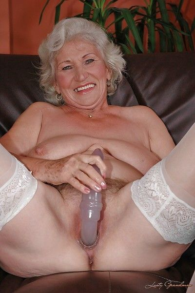 Lecherous granny wide blanched stockings masturbating their way twat adjacent to a chunky dildo