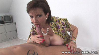 Oiled fat interior milf gives a cum milking handjob in the air a younger bloke