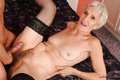 Curt haired granny everywhere stockings gives a blowjob coupled with gets shagged
