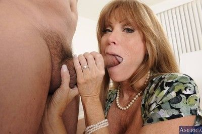 Through-and-through consequential titted cougar banged involving their way abode