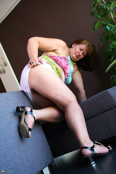 Obese dutch housewife express grim