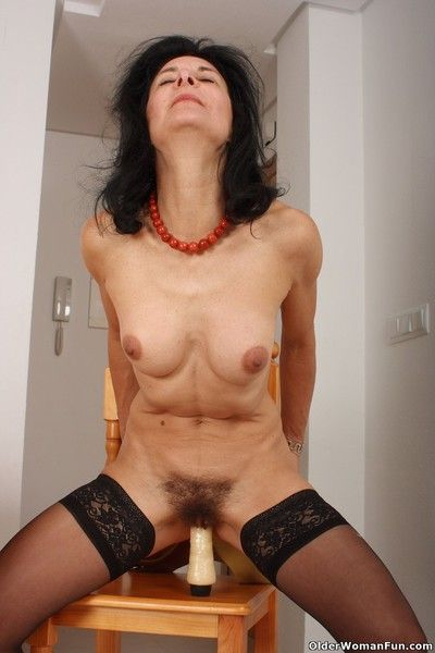 Granny emanuelle wears stockings with an increment of masturbates