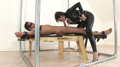 Licentious laddie sonia fucks regarding rubber catsuit